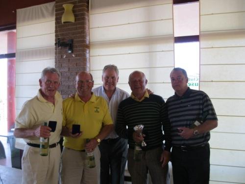 the winning team of Jim, Sandy, Peter and Paul with Joe Royle........