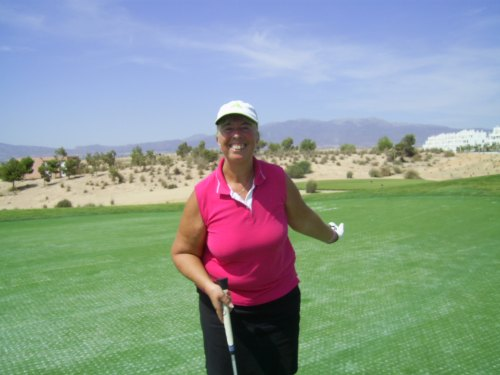 Is Lesley pointing to the ball in the hole?............