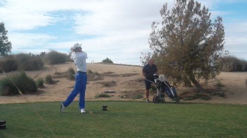professional and caddie on the14th at El Valle........