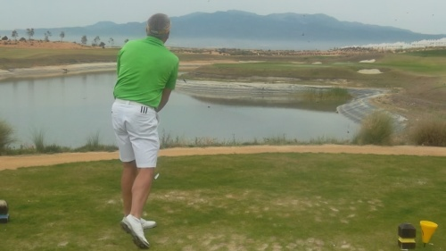 Tim Beisiegel picks a path through the swifts towards the green with a 9 iron......