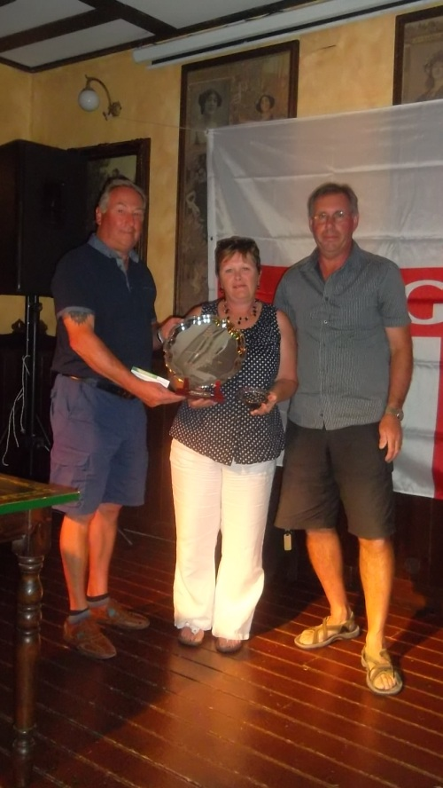 Barbara gets her trophy from vice-captain Dave (also hubby!) and captain Paul.....