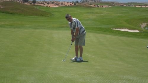 Nick Seward has a long tricky putt on 18..........................